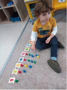 Mathematics- child playing with numbers